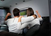 Couple having fun watching soccer game