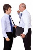 Angry senior businessman punching young attractive businessman, isolated on a white background