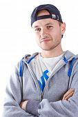 Постер, плакат: Портрет молодого человека в шляпе спорта над белой