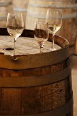 Wine Glasses On An Old Barrel