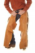 image of crotch  - A cowboy is standing with his hands in his belt loops - JPG