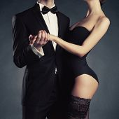 picture of fine art portrait  - Art photo of a young couple in sensual lingerie and a tuxedo - JPG