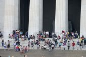 WASHINGTON, D.C. - JULY 29: Tourists stand outside the Lincoln Memorial on July 29, 2013 in Washingt