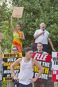 People With Opposing Religious And Gender Beliefs Hold Signs And Preach At The Bele Chere Festival I