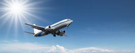 foto of aeroplan  - aeroplane flying on a clear blue sky - JPG
