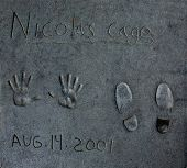 HOLLYWOOD, CALIFORNIA - APRIL 12, 2013: Nicolas Cage handprints printed in August 14, 2001 on Hollyw