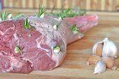 pic of lamb  - Fresh raw leg of lamb with rosemary and garlic  - JPG