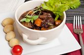 stock photo of boeuf  - Boeuf bourguignon with carrots onions and mushrooms - JPG
