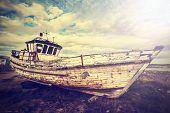 pic of junk-yard  - Vintage Old Boat on Junk Yard with back light - JPG