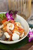 image of green papaya salad  - Traditional dish of freshly prepared Thai food. Thai seafood and som tum green papaya salad.