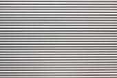 stock photo of roller shutter door  - dirty metal roller shutter door as a background - JPG