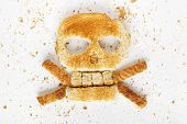 pic of skull crossbones  - Stock image image of bread skull and crossbones with crumbs on white background