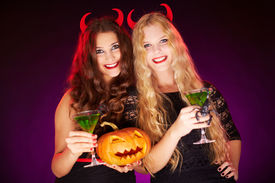 pic of antichrist  - Photo of smiling females holding Halloween pumpkin and cocktails with scorpions - JPG