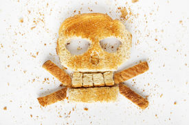 pic of skull crossbones  - Stock image image of bread skull and crossbones with crumbs on white background  - JPG