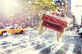 image of santa sleigh  - Santa flying his sleigh against new york street - JPG