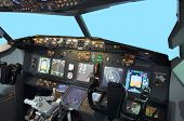 pic of yoke  - A view from inside flight simulator B737 cockpit with light blue screen in the front window - JPG