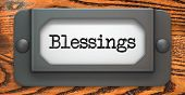 image of divine mercy  - Blessing Inscription on File Drawer Label on a Wooden Background - JPG