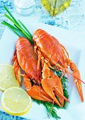 stock photo of crawfish  - boiled crawfish with fresh lemon on the plate - JPG