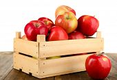 image of wooden crate  - Crate of apples on wooden table - JPG