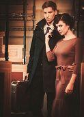 pic of passenger train  - Vintage style couple inside retro train coach  - JPG