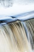 pic of dimples  - Dimple forms in water pouring over spillway - JPG