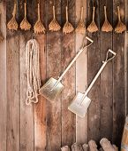 stock photo of barn house  - close up Two shovels of an old country house on vintage wooden wall - JPG
