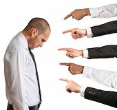 stock photo of indications  - A Businessman accused with hands that indicate - JPG