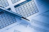 stock photo of budget  - Operating budget calendar and pen in closeup - JPG