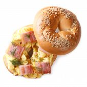 foto of scrambled eggs  - bagel with scrambled eggs and bacon closeup isolated on white background - JPG