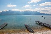 picture of dock a pond  - Dock on the lake at the mountains and blue sky - JPG