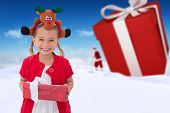 image of rudolph  - Cute little girl wearing rudolph headband against bright blue sky over clouds - JPG