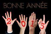 pic of bonnes  - Hands against glittering bonne annee - JPG