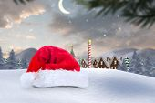 pic of north-pole  - Santa hat on snow against cute christmas village at north pole - JPG