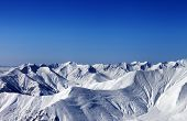 foto of avalanche  - Winter snowy mountains with avalanche at evening - JPG