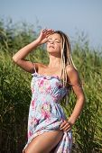 pic of minx  - Happy young woman with dreadlocks on nature background - JPG