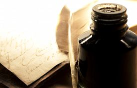 picture of inkpot  - Old book with feather and inkpot in closeup - JPG