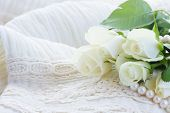 image of mother-of-pearl  - white fresh roses with pearls on white lace background - JPG