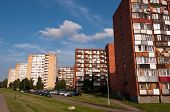 stock photo of brick block  - Typical socialist blocks of flats of red bricks built during communism period in Vilnius - JPG