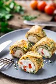 picture of curd  - Omelette rolls with curd and herbs on a plate - JPG
