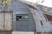 picture of anza  - Building shed made of corrugated metal and rusted deterioration - JPG