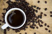 pic of coffee crop  - Coffee beans background on wooden - JPG