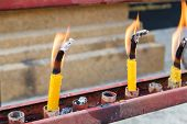 foto of worship  - flame of candle for worship in thailand temple - JPG