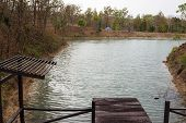 foto of pier a lake  - wooden pier beside the lake in forest - JPG
