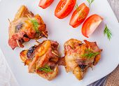 picture of plum tomato  - Baked chicken wings with plum on a white plate - JPG