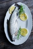 stock photo of brook trout  - Fresh trout with lemon and rosemary - JPG