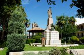 stock photo of senora  - Bandstand and religious monument in the gardens in front of the Parish of our Lady of the Assumption church  - JPG