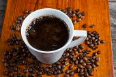 picture of coffee coffee plant  - Coffee beans and cup of coffee on wooden table - JPG