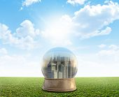 picture of smog  - A snow globe with a city surrounded by pollution and smog on a perfect flat green lawn against a blue sky with white clouds - JPG