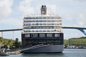 picture of curacao  - Luxury blue and white cruise ship moored beside bridge in Curacao - JPG