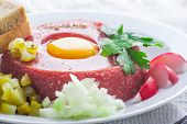 stock photo of tatar  - Fresh beef tatar with egg on white plate - JPG